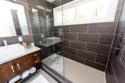 Austin custom home builders shipping container bathroom tile shower