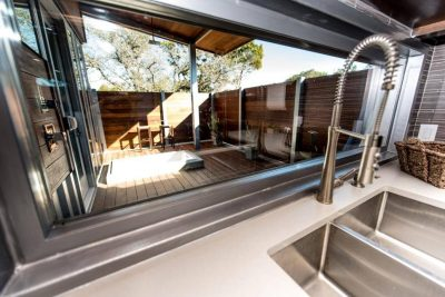 Austin Custom home build with shipping containers deck outdoor living space