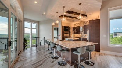 Kitchen with counter seating Austin custom home builders
