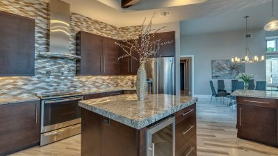 Austin custom home builder gorgeous kitchen island with built in wine cooler