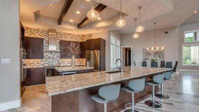 Austin custom home builder beautiful kitchen with granite counters pendent lighting